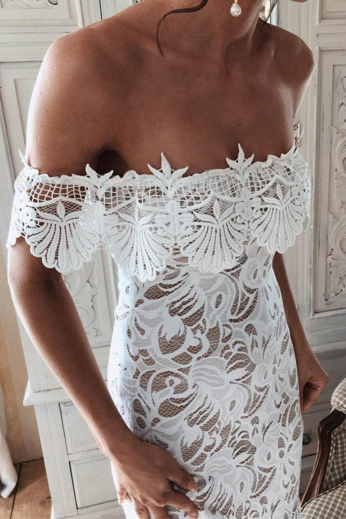 Close-up of bride wearing Grace Loves Lace Cien Gown