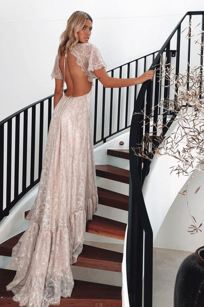 Back shot of bride wearing Grace Loves Lace Capri Gown walking up stairs