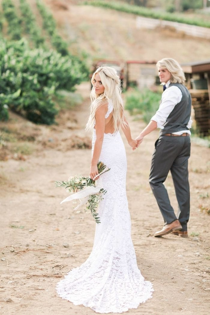 Bride wearing Grace Loves Lace Alexandra Gown holding hands with groom