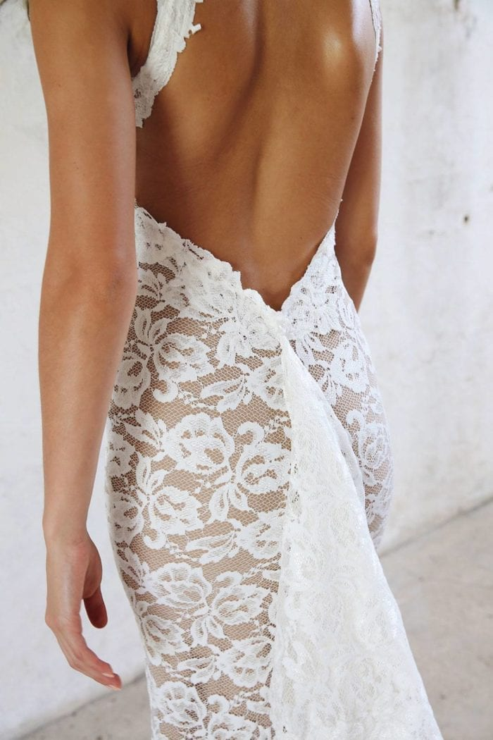 Back shot of bride wearing Grace Loves Lace Alexandra Gown with train pinned up