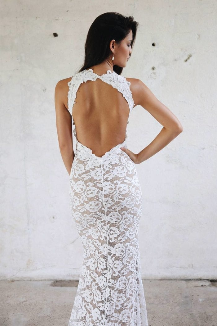 Back shot of bride wearing Grace Loves Lace Alexandra Gown with hand on hip