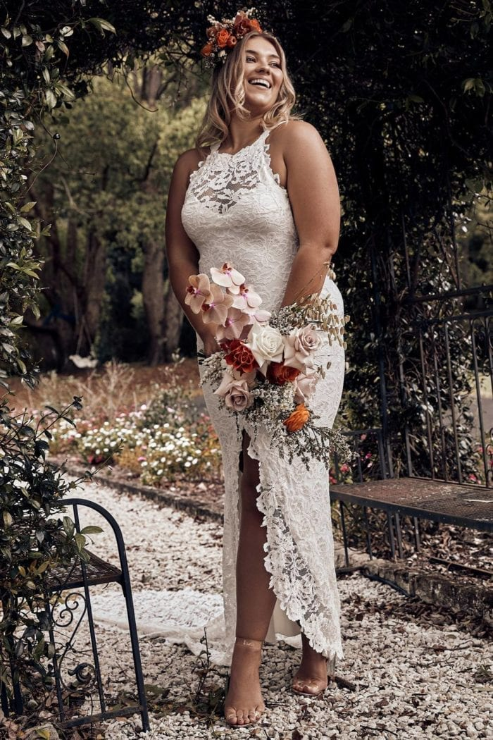 Bride wearing Grace Loves Lace Alexandra Gown holding bouquet