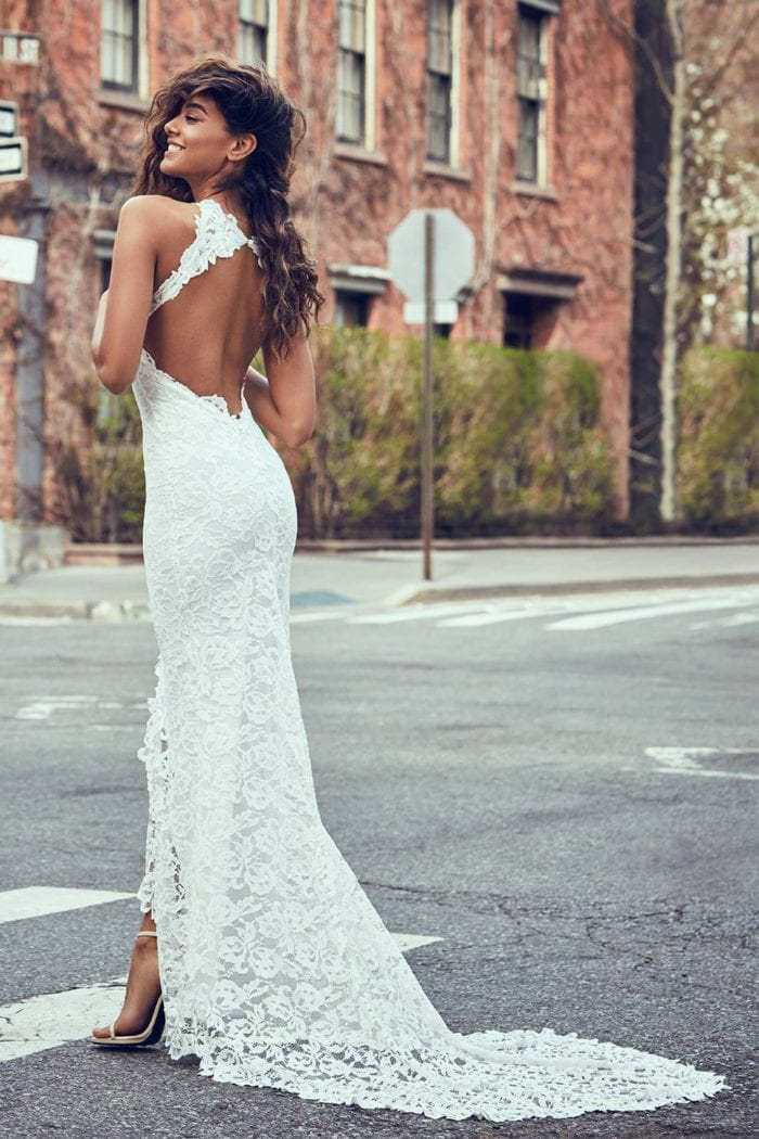 Back shot of bride wearing Grace Loves Lace Alexandra Gown on pedestrian crossing