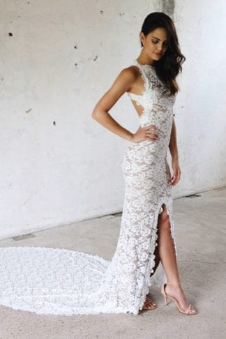 Bride wearing Grace Loves Lace Alexandra Gown with hand on hip