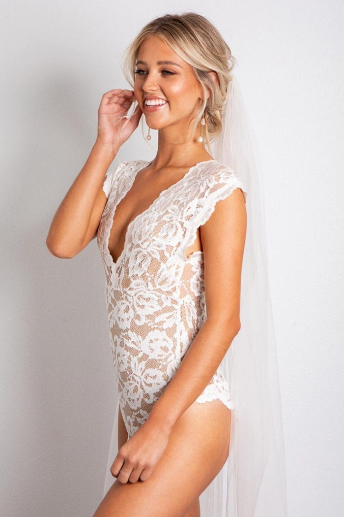Bridesmaid wearing Grace Loves Lace Gigi Bodysuit with nude lining