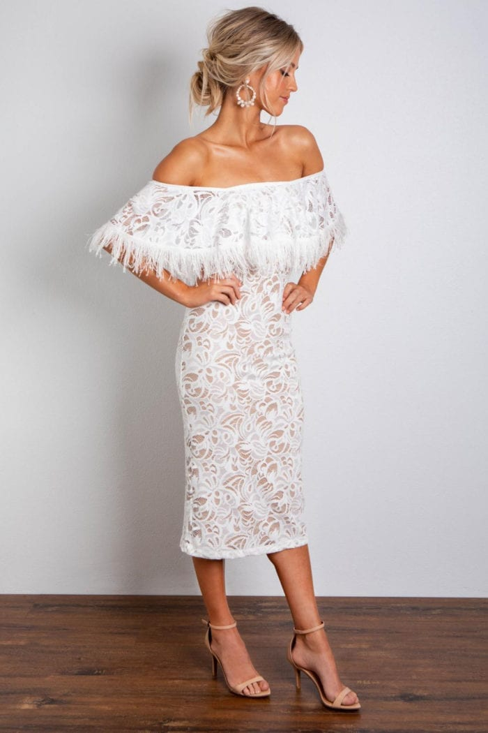 Bridesmaid wearing Grace Loves Lace Dominga Dress with Nude Lining with hands on hips