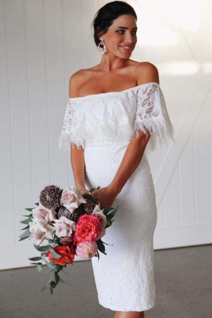 Bridesmaid wearing Grace Loves Lace Dominga Dress with Ivory Lining holding bouquet