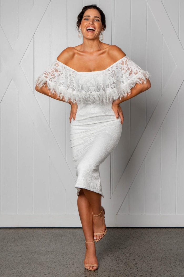 Bridesmaid wearing Grace Loves Lace Dominga Dress with Ivory Lining with hands on hips