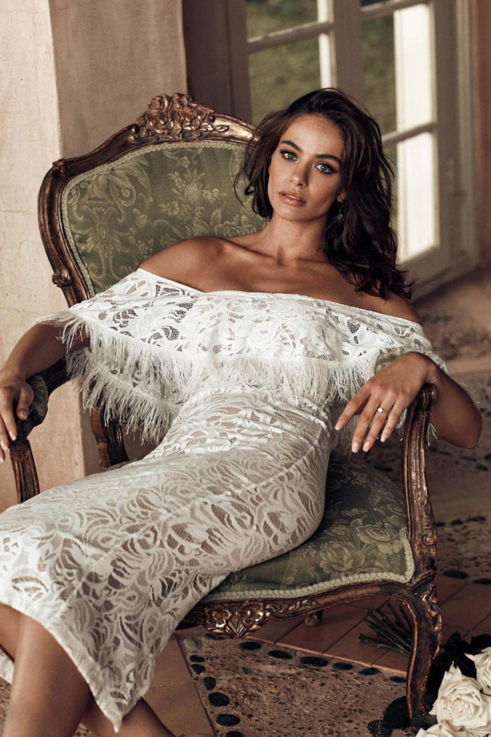 Bridesmaid wearing Grace Loves Lace Dominga Dress with Nude Lining sitting on extravagant chair