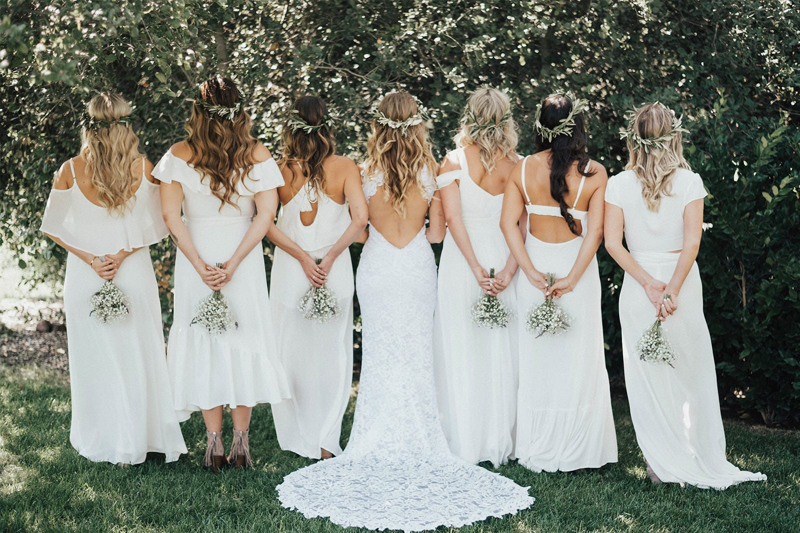 Bride wearing Grace Loves Lace Alexandra Gown standing with bridesmaids