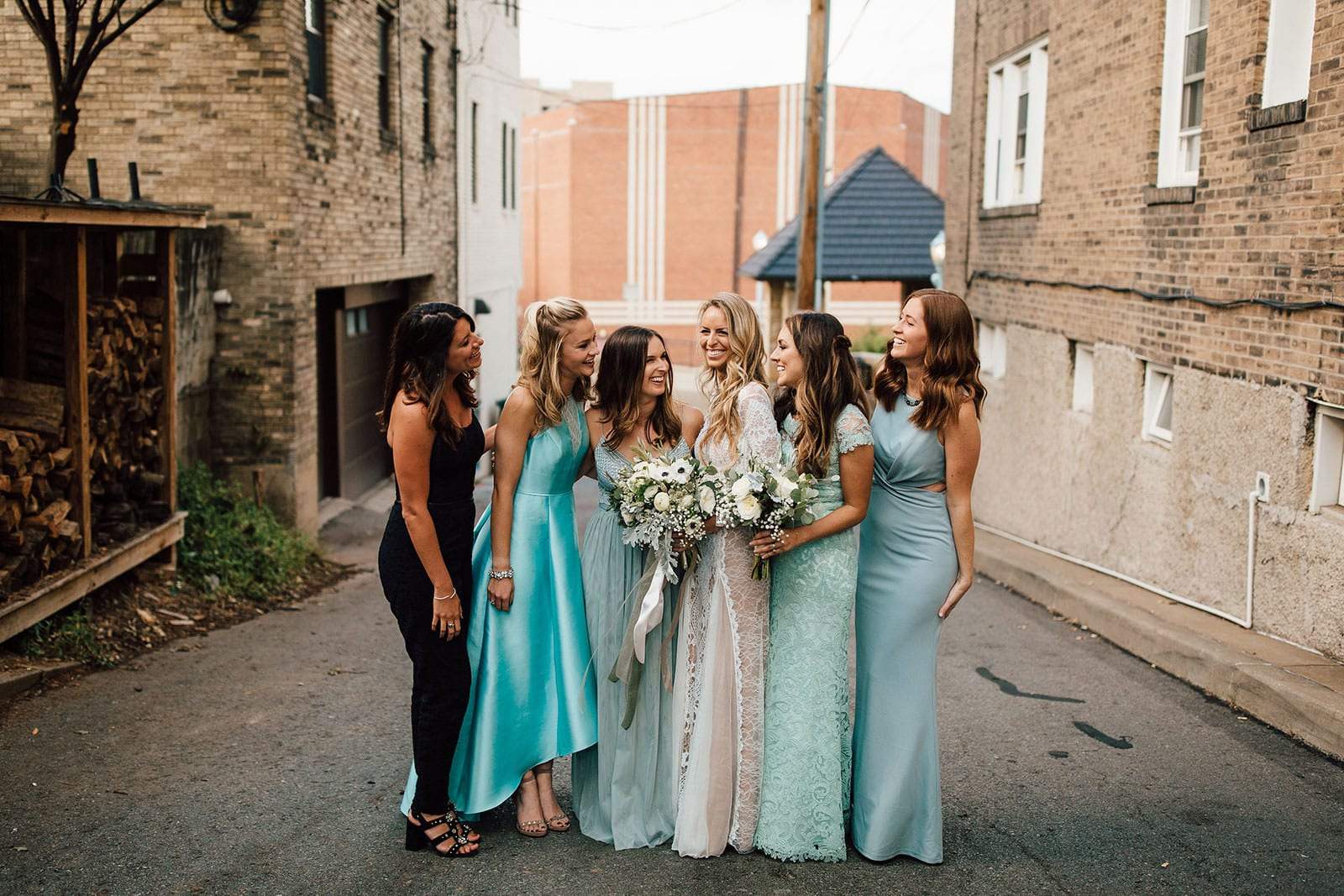 Bride wearing Grace Loves Lace Inca Gown standing with bridesmaids