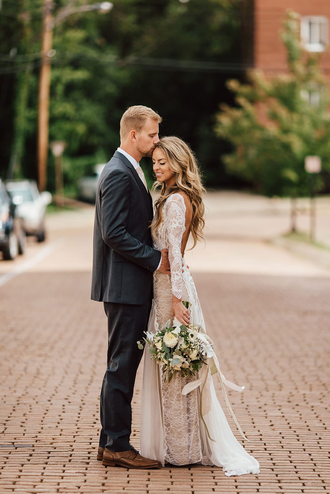 Bride wearing Grace Loves Lace Inca Gown bring kissed by groom