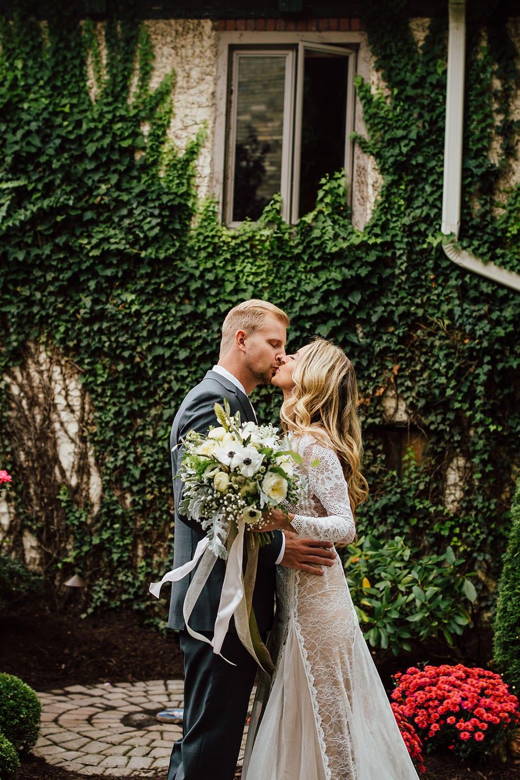 Bride wearing Grace Loves Lace Inca Gown kissing groom