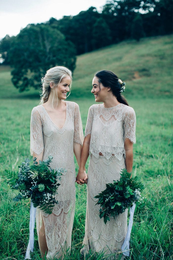 Bridesmaids wearing Grace Loves Lace Lace Maxi Dress in Champagne holding bouquets