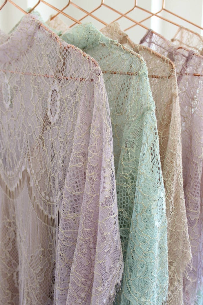 Grace Loves Lace Lace Maxi Dress in Amethyst, Peridot and Champagne on bronze clothes hangers