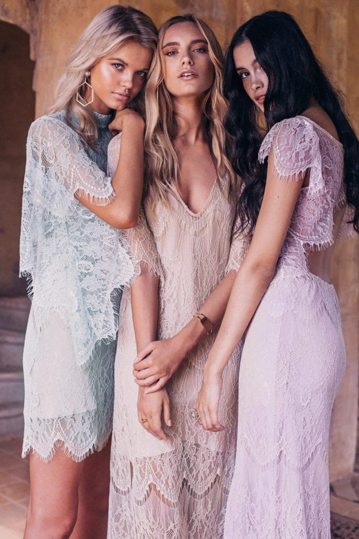 Three bridesmaids wearing Grace Loves Lace Lace Maxi Dress in Amethyst, Peridot and Champagne