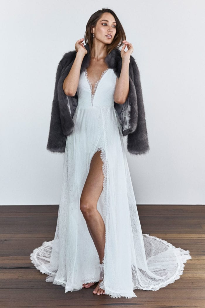 Bride wearing Grace Loves Lace Joplin Jacket over wedding gown