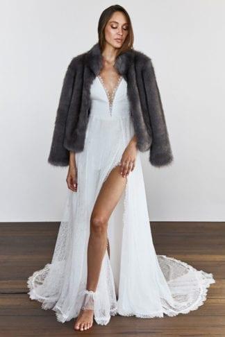 Bride wearing Grace Loves Lace Joplin Jacket over wedding gown