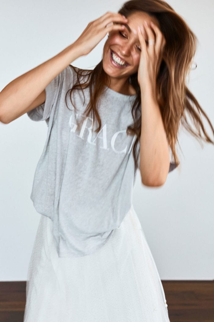Bridesmaid wearing Grace Loves Lace Grace Tee in Grey with hands in hair