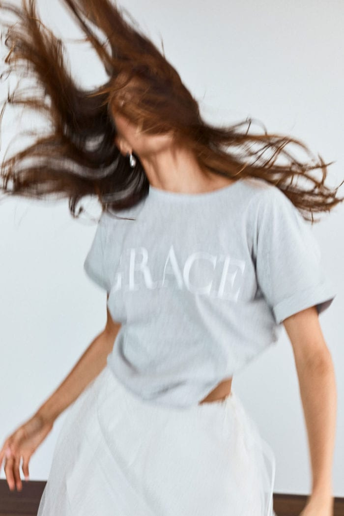 Bridesmaid wearing Grace Loves Lace Grace Tee in Grey dancing