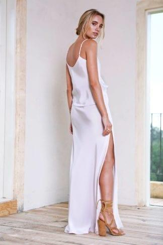 Back shot of bridesmaid wearing Grace Loves Lace Belle Silk Split Skirt in Oyster
