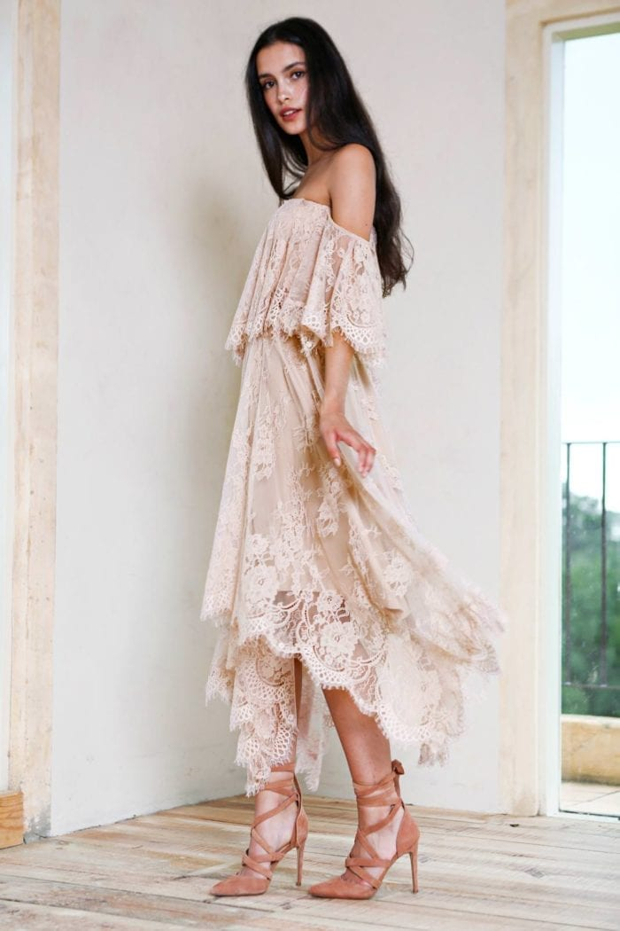 Bridesmaid wearing Grace Loves Lace Belle Lace Swing Skirt in Sandstone holding skirt in hand