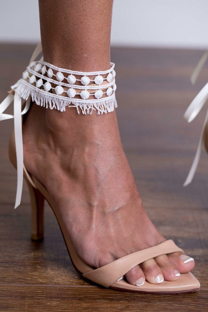 Close-up of bride wearing Grace Loves Lace Tribe Anklets