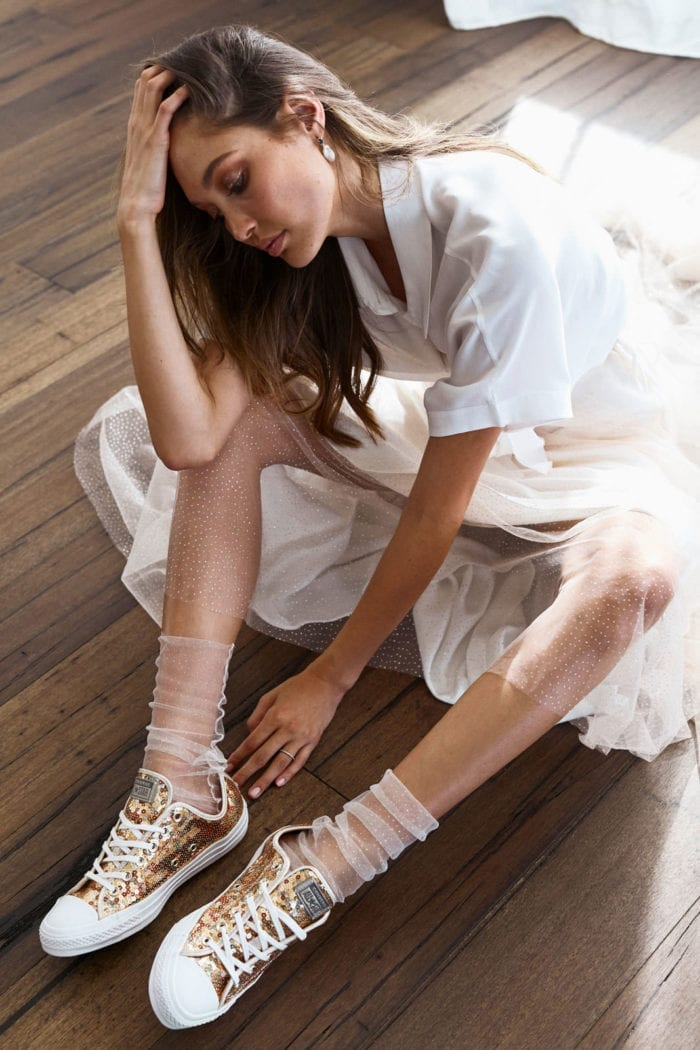 Bride wearing Grace Loves Lace Shimmy Socks and sneakers