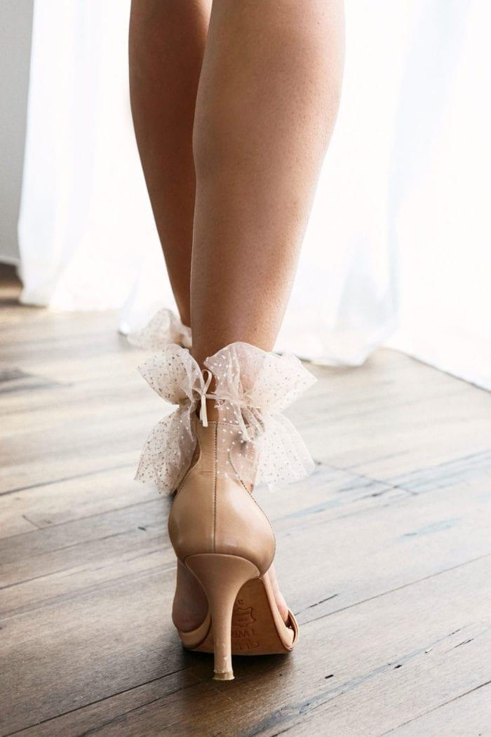 Back shot of bride wearing Grace Loves Lace Shimmy Anklets