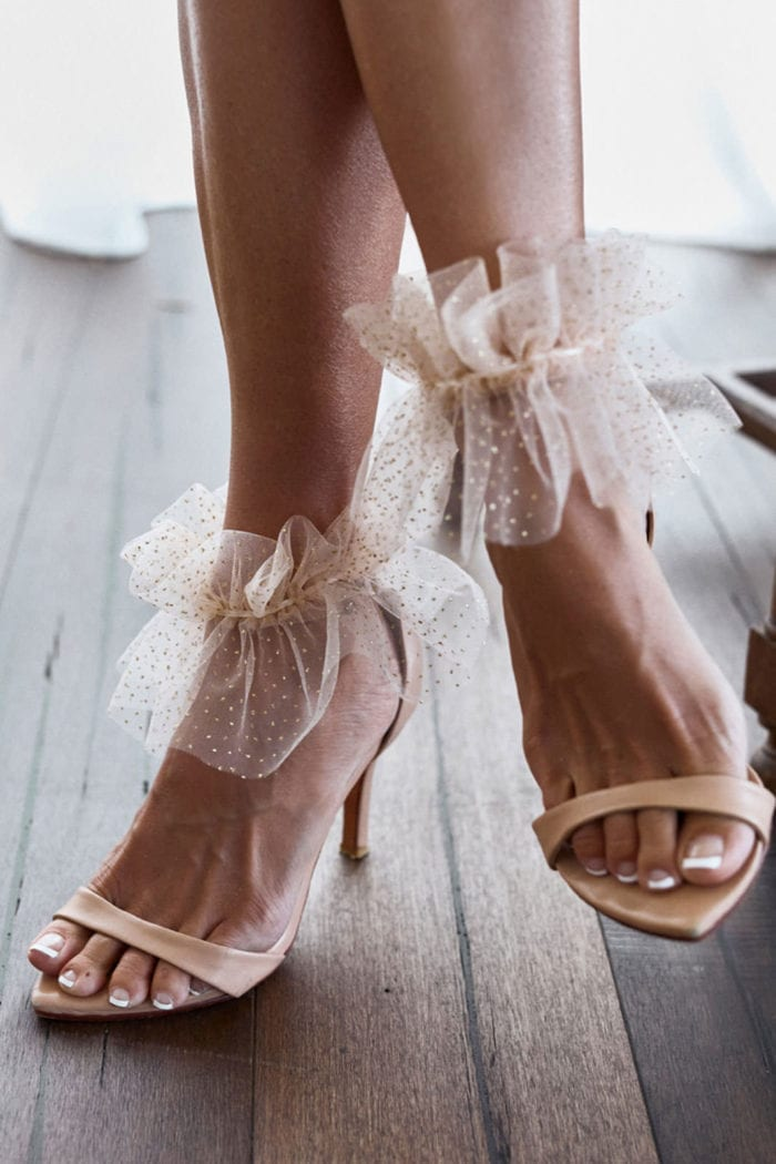 Close-up of bride wearing Grace Loves Lace Shimmy Anklets