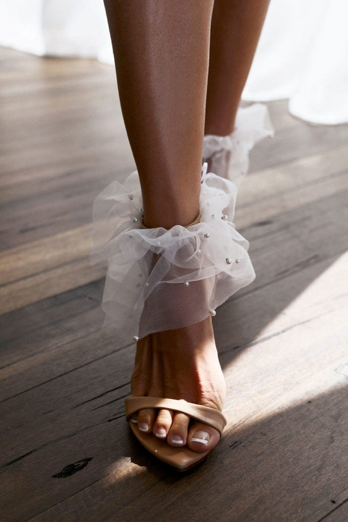 Bride wearing Grace Loves Lace Pearly Anklets