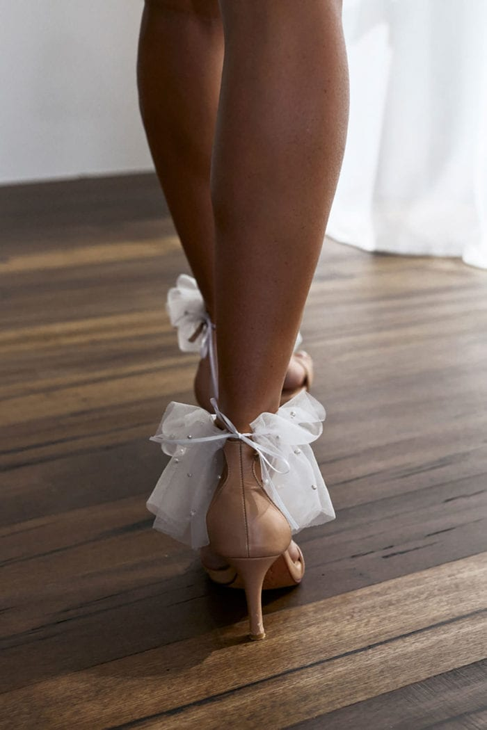 Back shot of bride wearing Grace Loves Lace Pearly Anklets