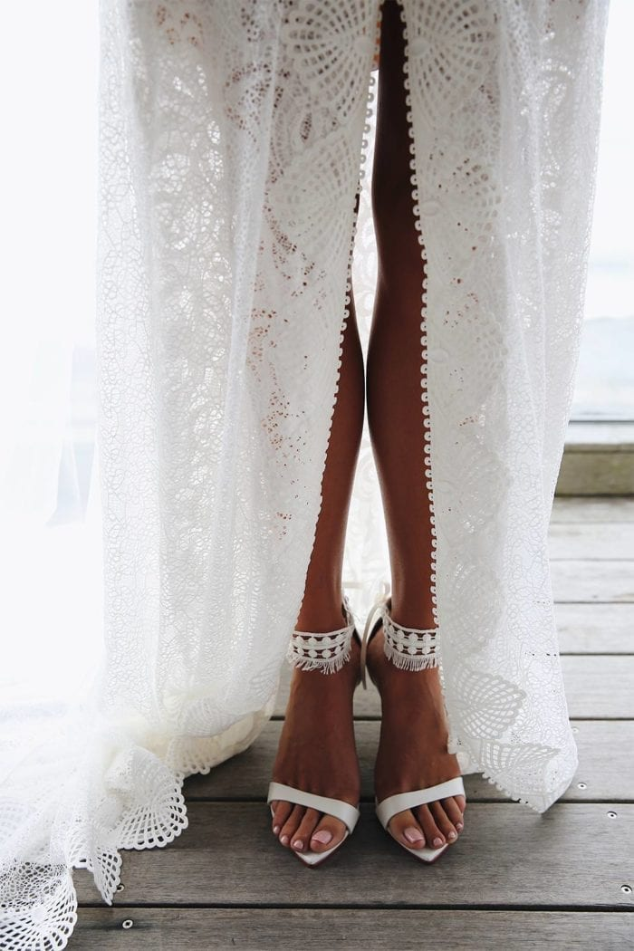 Bride wearing Grace Loves Lace Dosa Heels in White