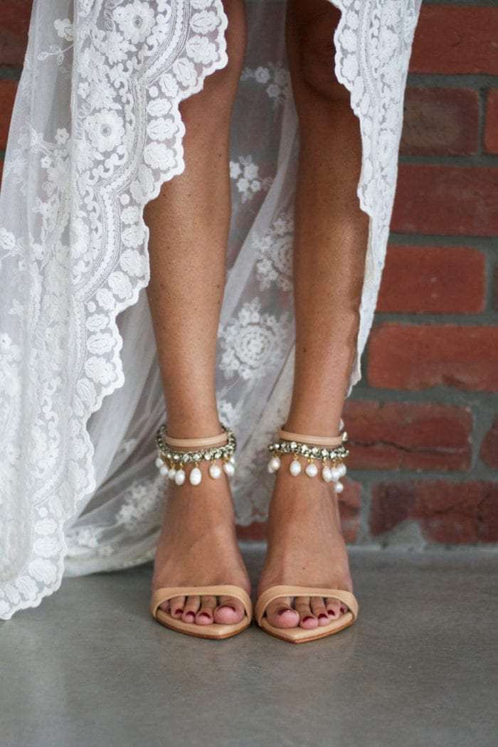 Bride wearing Grace Loves Lace Dosa Heels in Nude with Hera Anklets