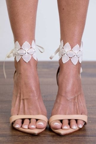 Close-up of bride wearing Grace Loves Lace Bloom Anklets