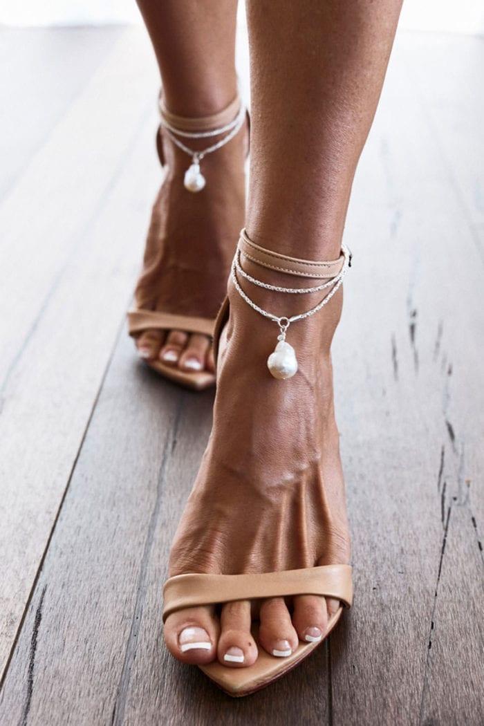 Close-up of bride wearing Grace Loves Lace Artemis Anklets