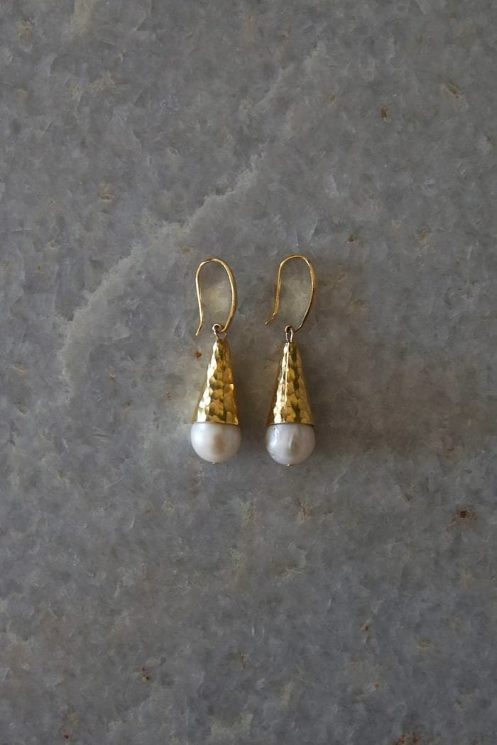 Grace Loves Lace Virtue Earrings in Pearl and Gold on grey marble