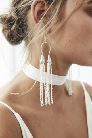 Close-up of bride wearing Grace Loves Lace Salita Earrings
