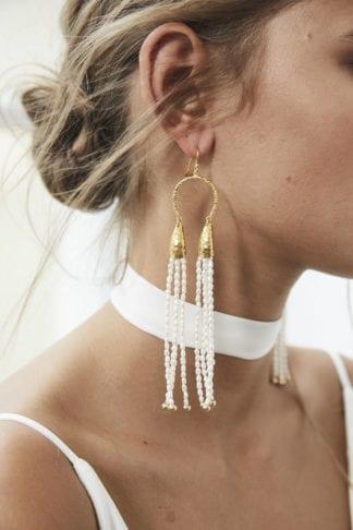 Close-up of bride wearing Grace Loves Lace Salita Earrings