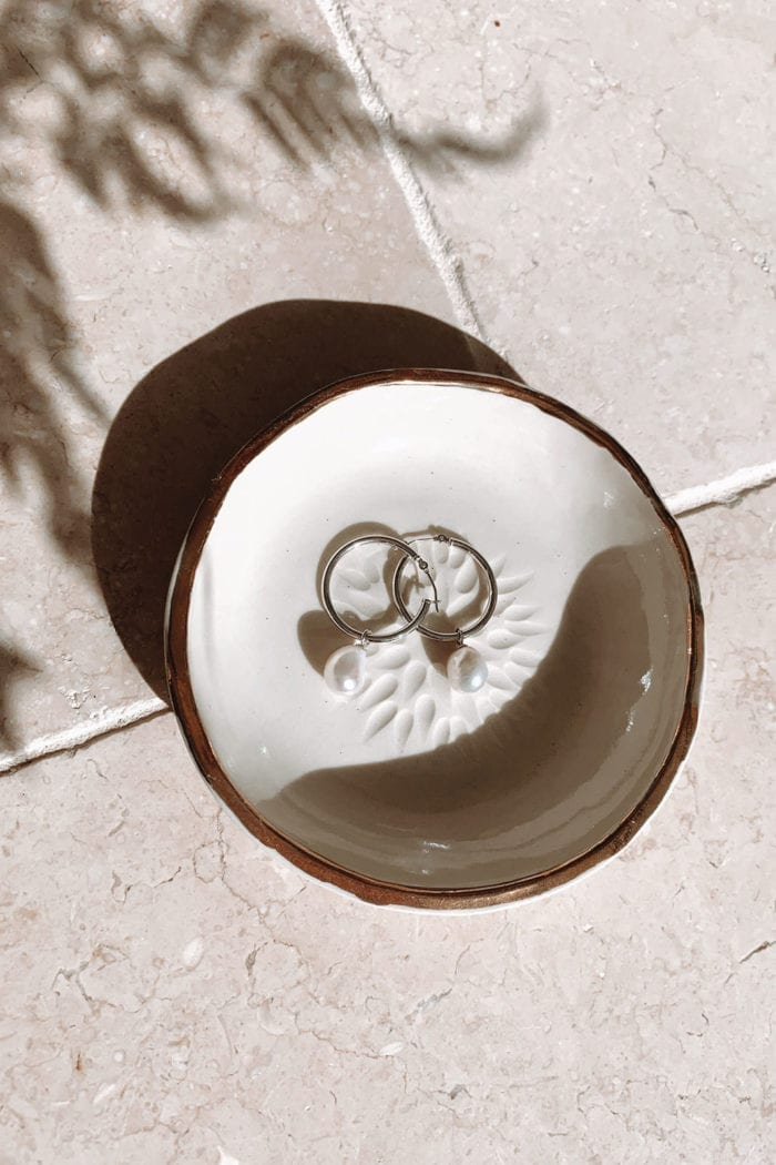 Grace Loves Lace Sade Earrings in white dish on ceramic tiles