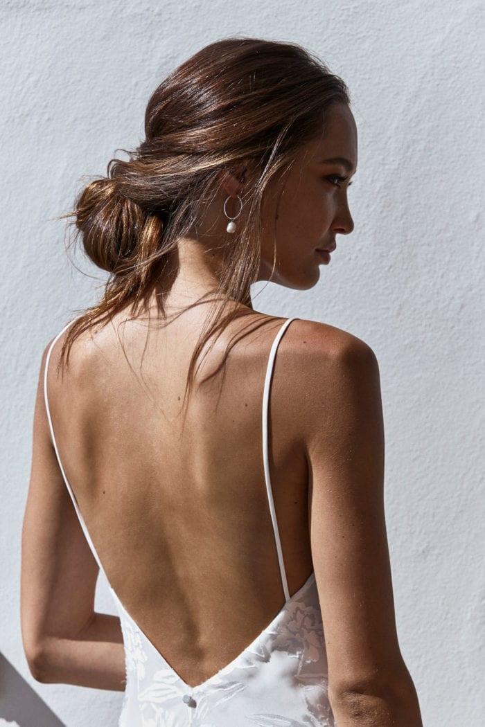 Back shot of bride wearing Grace Loves Lace Sade Earrings