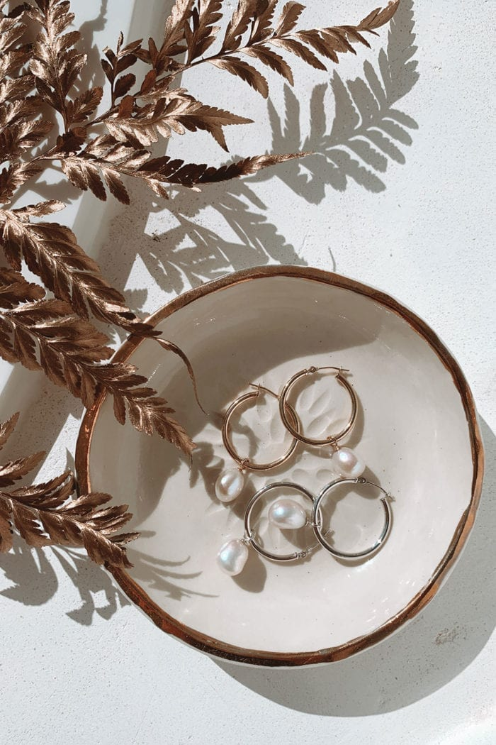 Grace Loves Lace Sade Earrings in white dish with rose gold leaves