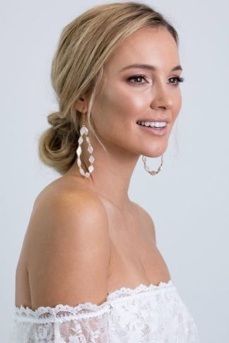Bride wearing Grace Loves Lace Nova Diamond Loop Earrings looking to the side