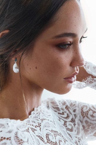 Close-up of bride wearing Grace Loves Lace Nini Earrings