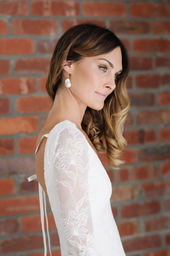 Side shot of bride wearing Grace Loves Lace Maya Earrings