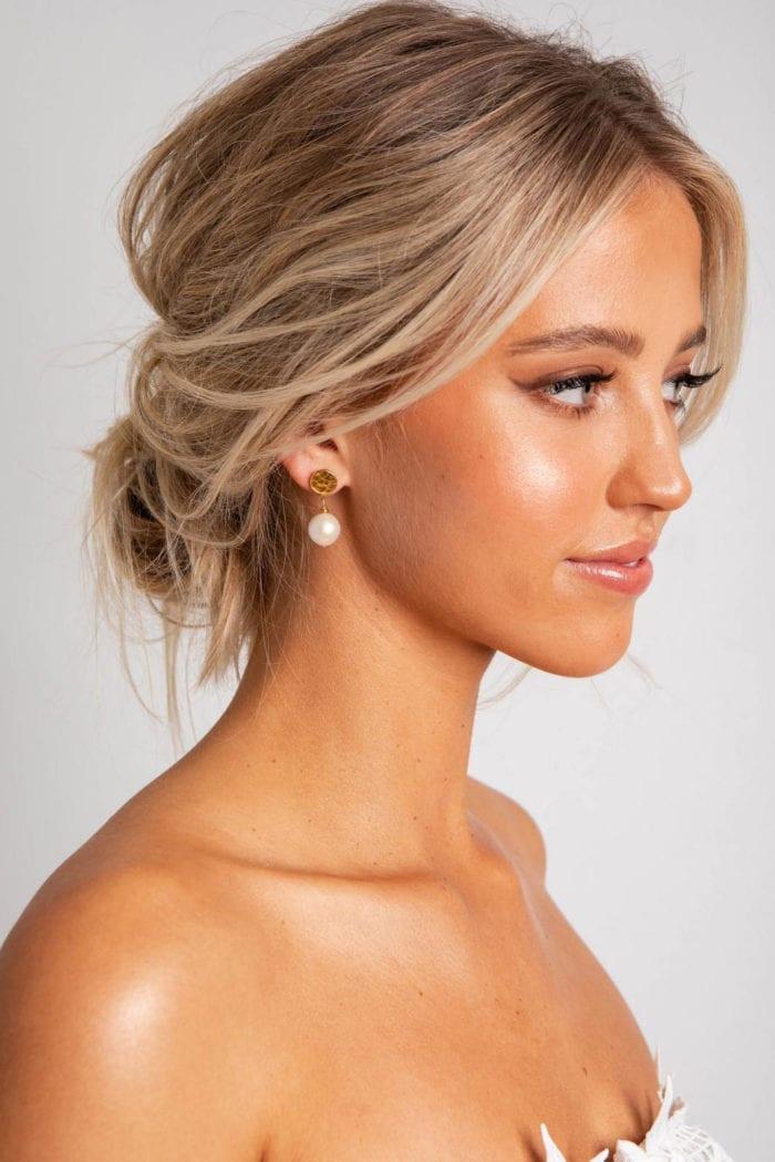 Side shot of bride wearing Grace Loves Lace Lyra Earrings