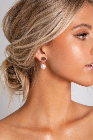 Bride wearing Grace Loves Lace Lyra Earrings looking to the side