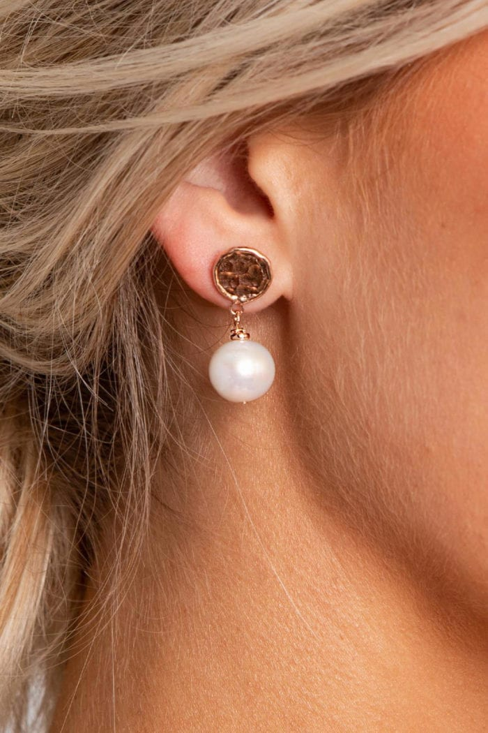 Close-up of bride wearing Grace Loves Lace Lyra Earrings