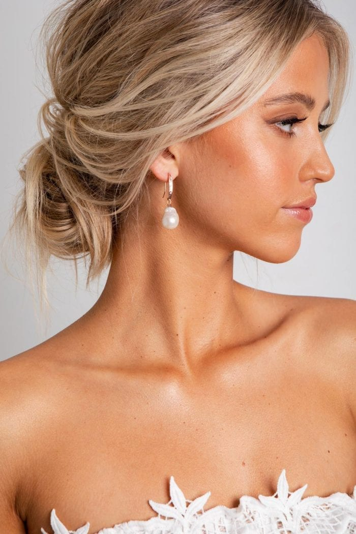 Bride wearing Grace Loves Lace Gaia Earrings looking to the side