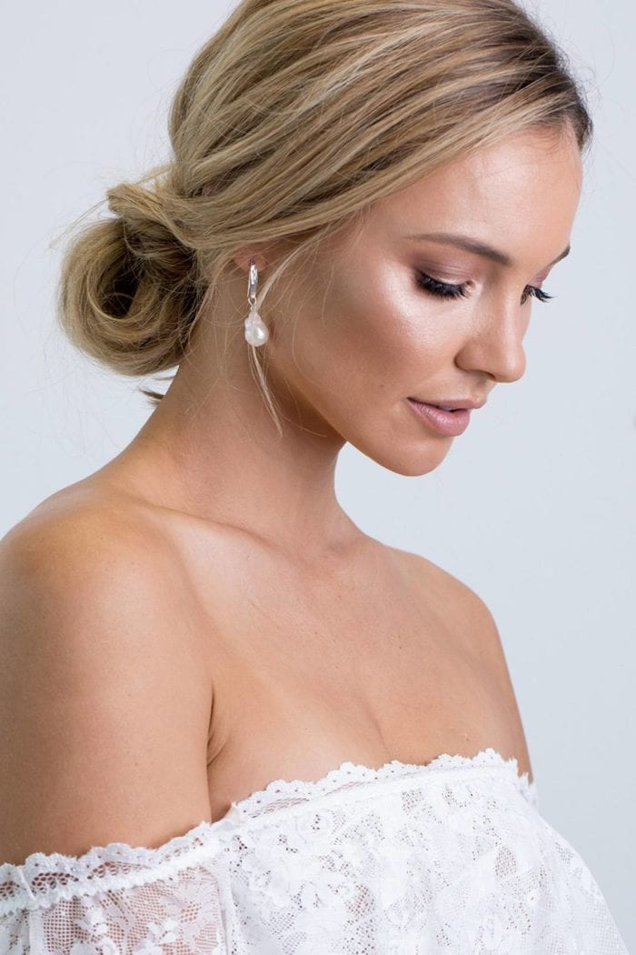 Bride wearing Grace Loves Lace Gaia Earrings looking down